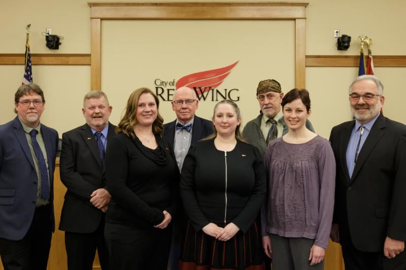 Photo of the 2019 City Council standing in the Council Chambers-from left to right Evan Brown Dean Hove Becky Norton Mayor Sean Dowse Laurel Stinson John Becker Erin Buss and Kim Beise.