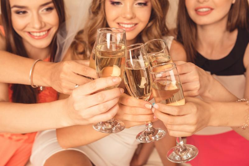 Happy Girls Celebrating A Bachelorette Party Of Bride with champagne.