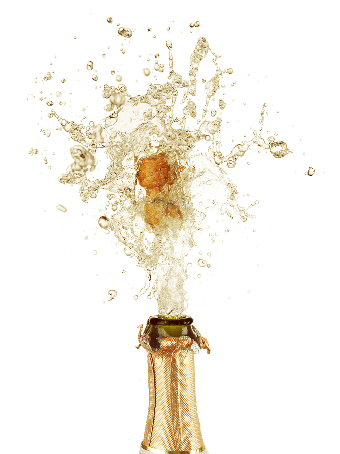 Close-up of explosion of champagne bottle cork