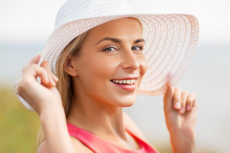 summer_ fashion and people concept - portrait of beautiful smiling woman in sun hat