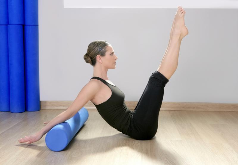 blue foam roller pilates woman sport gym fitness yoga wood floor