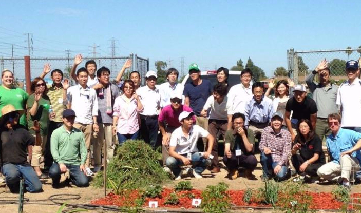 22 Japanese Expats pose near a garden at the Hope School in California