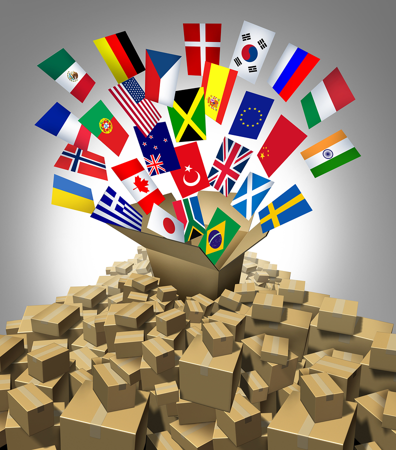 Global delivery Shipping and international package sending as a world parcel concept made of a mountain of cardboard boxes as a volcanoe with a group of flags as a symbol of fast service.