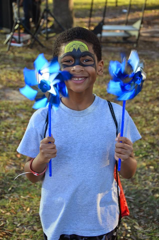 boy with pinwheels