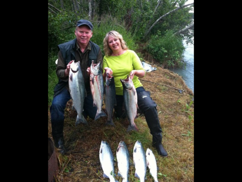 J.D. Duncan with his wife Rena bringing in a day's catch of salmon on the Kenai River!