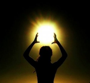 Silhouette of Woman Holding a Ball of Qi above Her Head