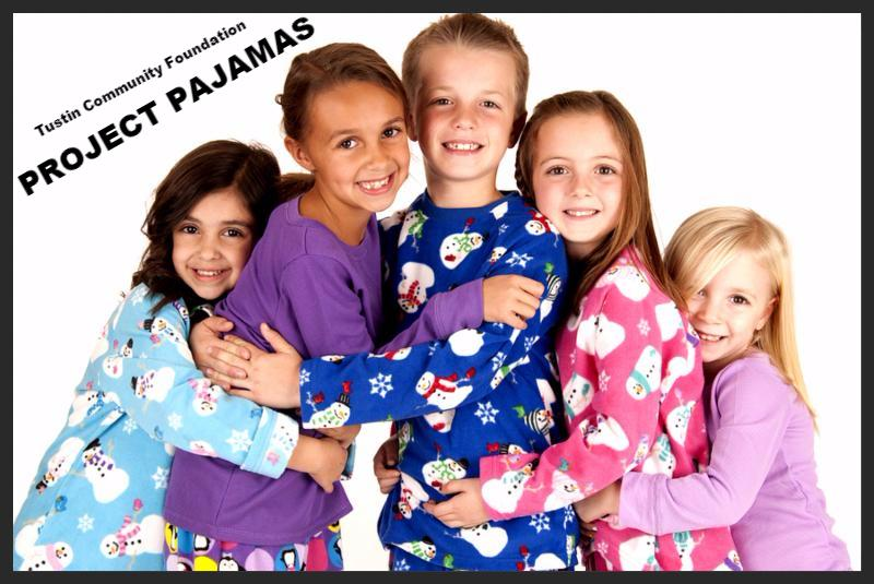 children in winter pajamas hugging each other     Note  Shallow depth of field