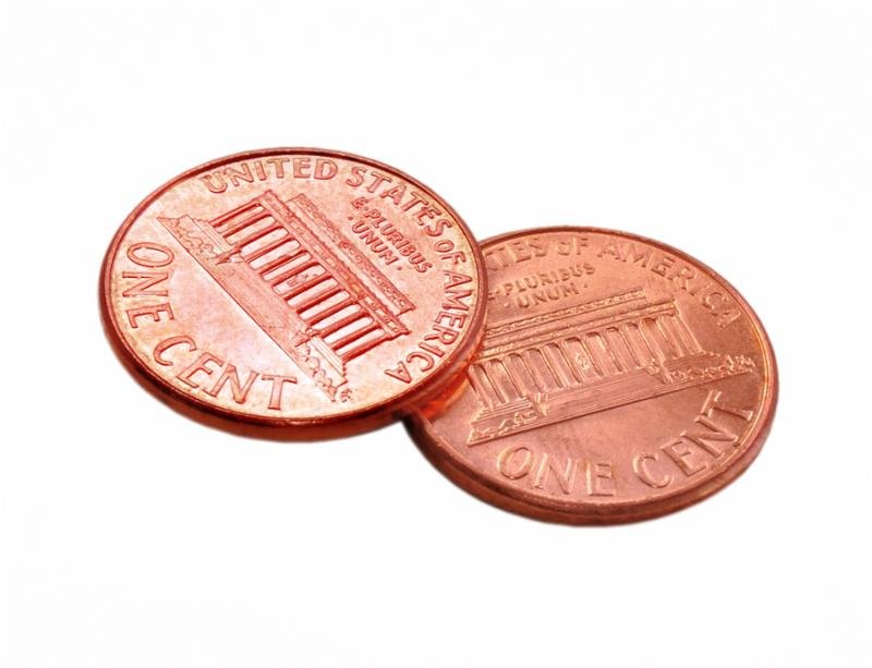 This is a picture of two shiny pennies   isolated over white