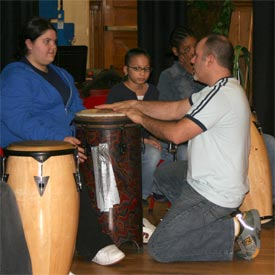 Students work on drumming with Josh Robinson