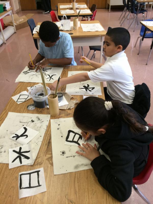 Students learn Chinese calligraphy