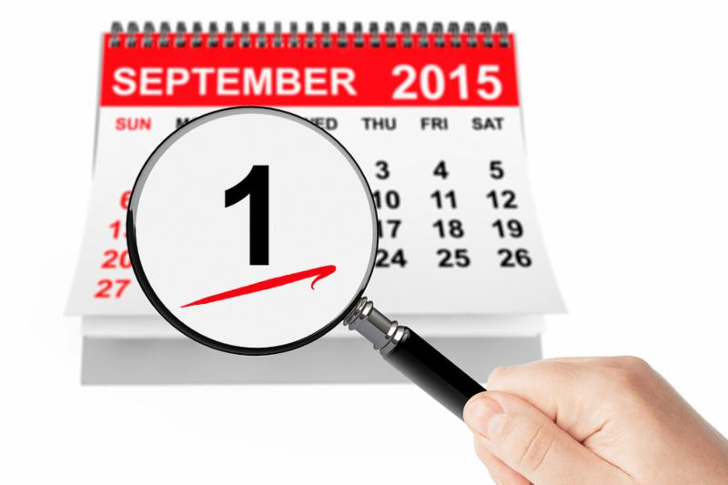 1 september Day Concept. 1 september 2015 calendar with magnifier on a white background