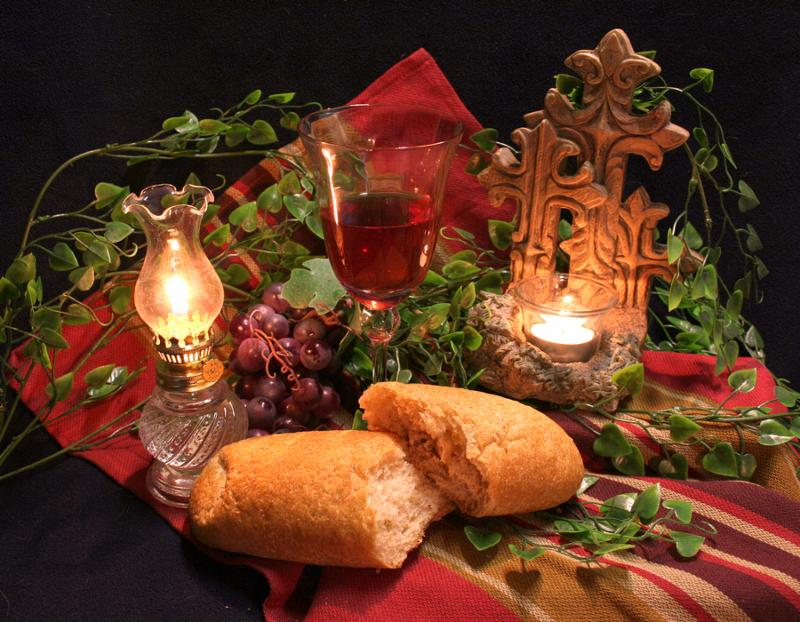 Communion still life - bread and wine with candles     Note  Slight graininess, best at smaller sizes