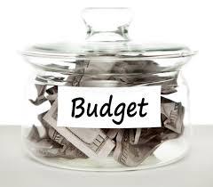 Jar of money labeled Budget