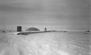 Amundsen-Scott South Pole Station as seen from my lab. The nearly drifted over Fuel Arch is the closest part of the complex. The door is clearly visible in the middle at the top of the end of the Arch. The main entrance is in front of the Arch, halfway alo