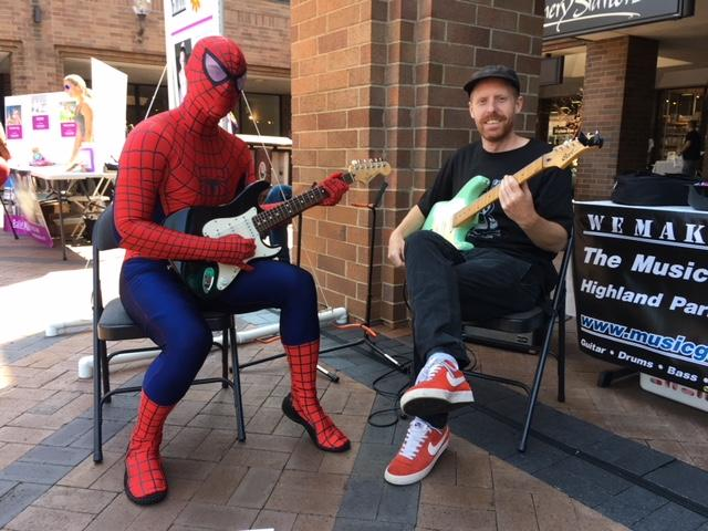 Spike playing guitar with Spiderman