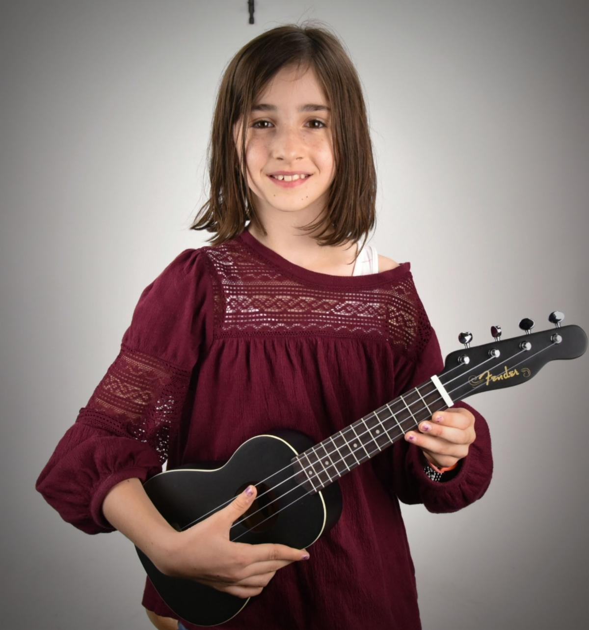 Young girl with Ukulele
