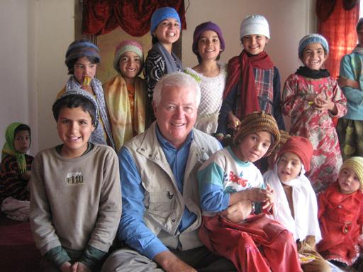 Bud MacKenzie with kids in hats