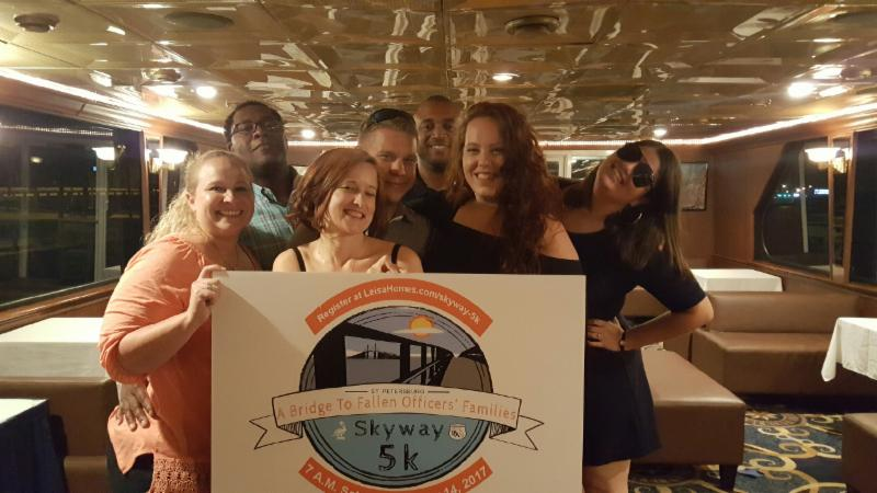 Skyway 5K Co- Partner and local ST. Pete Officer  LeNard Cox _ in the far left corner_ plaid green shirt_ at the PBA Sunset Cruise_
