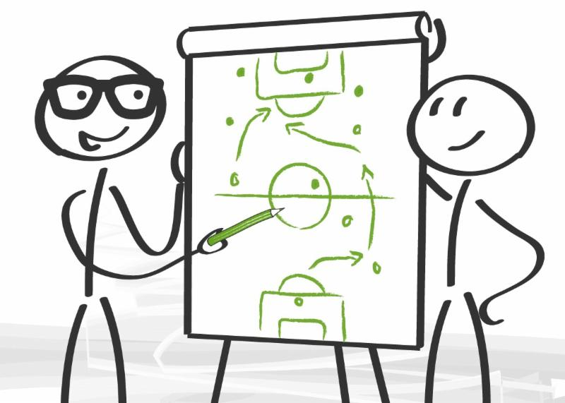 Two stick figures at a flip chart drawing up a game (or strategic) plan
