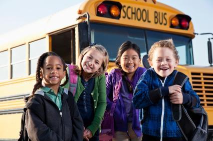 Children standing by bus