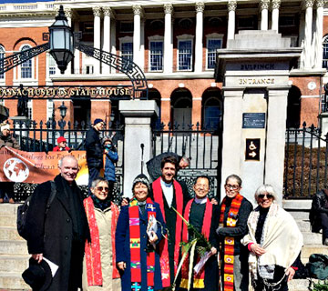 Faith leaders in front of State House