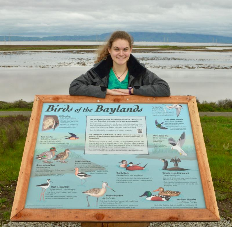 Photo of Sophie with one of her signs at the Baylands