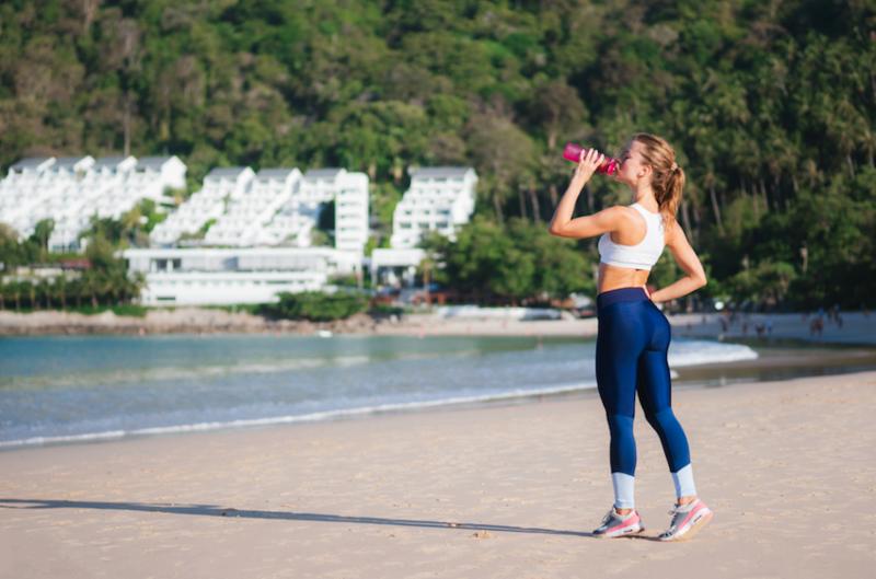Super fit woman drinking Sunrider Sunfit Shake