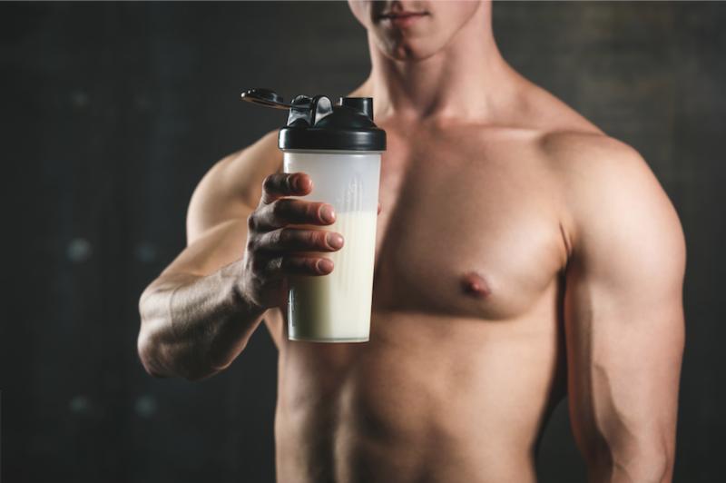 Muscular man drinking Sunrider Sunfit Shake