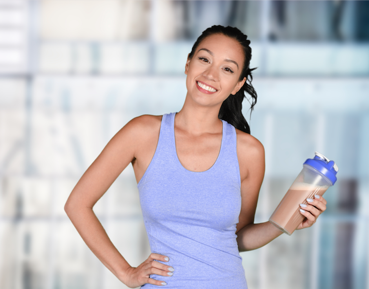 Young woman drinking Sunfit protein shake
