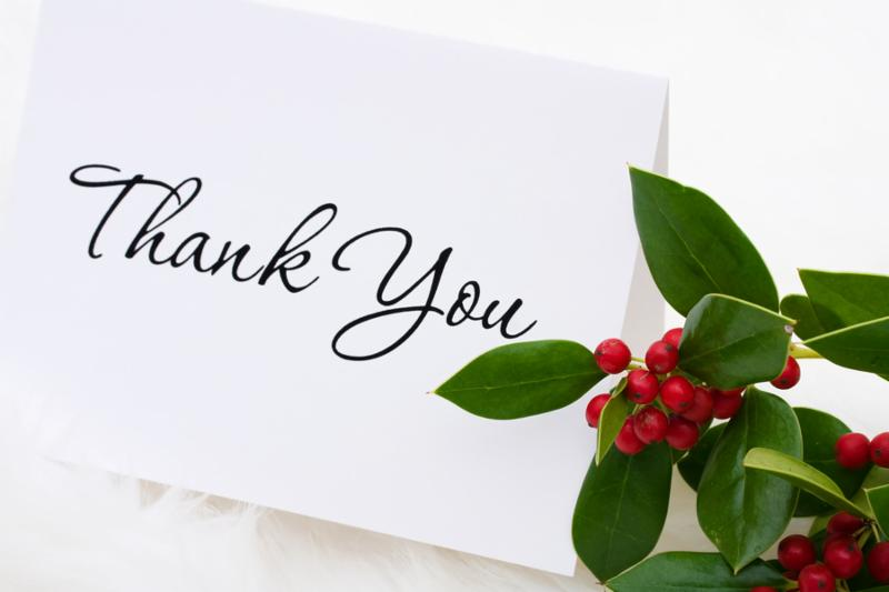 A thank you card with holly and berries on a white fur background thank you card