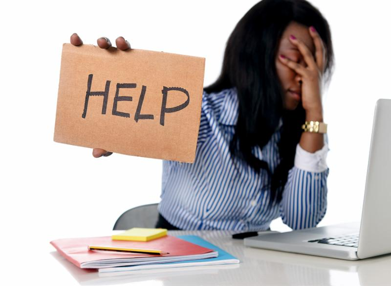 black African American ethnicity tired and frustrated woman working as secretary in stress at work office desk with computer laptop asking for help in business frustration concept
