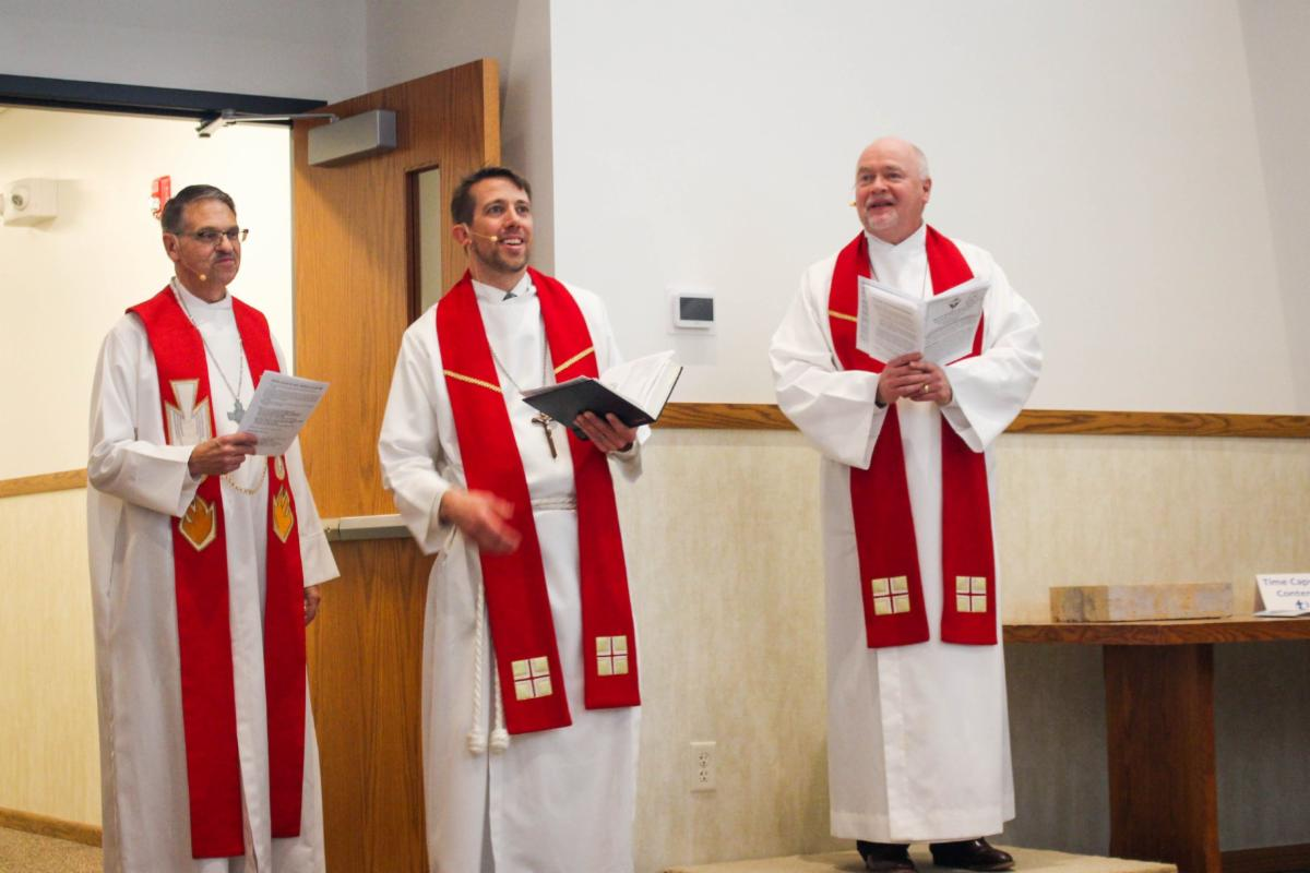 three pastors at the entrance of the new addition