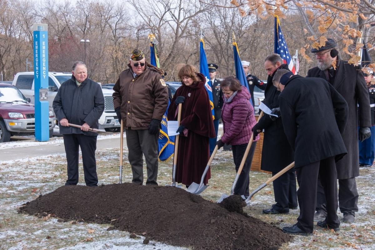 six officials with shovels for groundbreaking