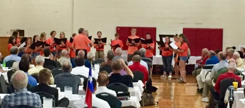 honor choir students singing in gymnasium