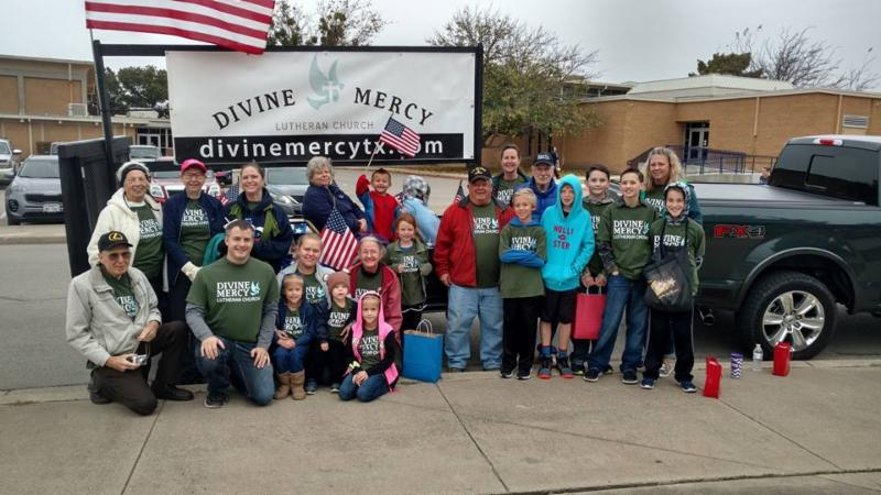 congregation members in front of parade float