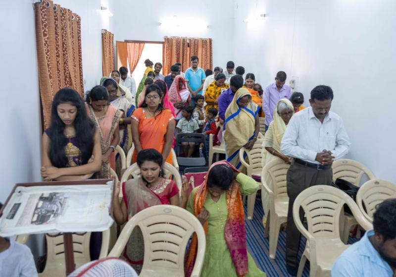 Indian congregation in prayer