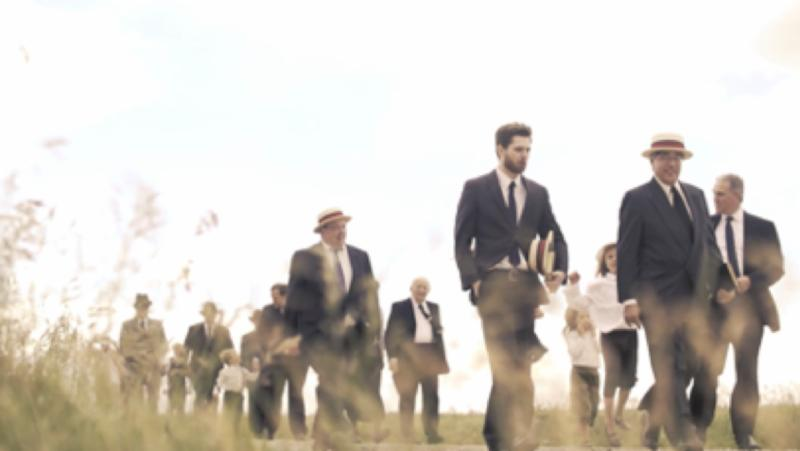 still image for centennial video showing actors walking to tent site