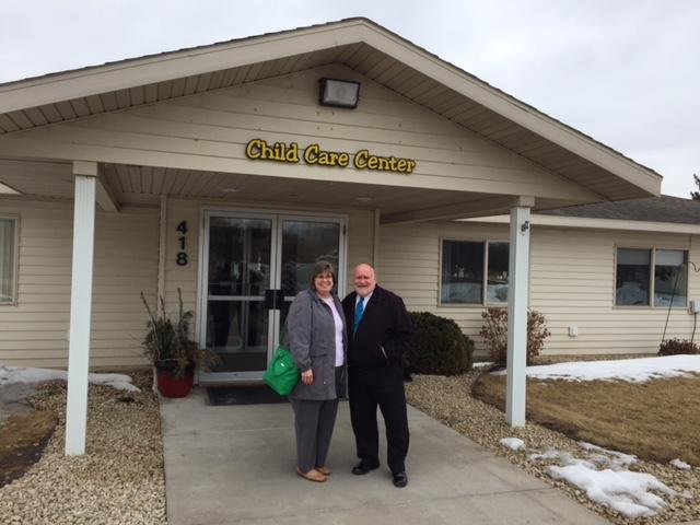 Pastor Rod and Beth Flohr in front of child care center building