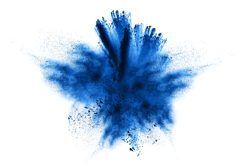 Abstract blue powder explosion on white background. Closeup of  blue dust particles splash isolated on  clear background.