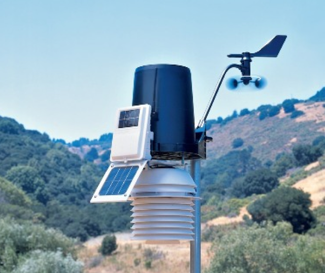 A weather station is shown out of doors.