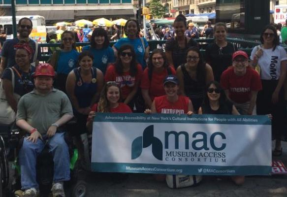 Members of Museum Access Consortium posing in front of banner