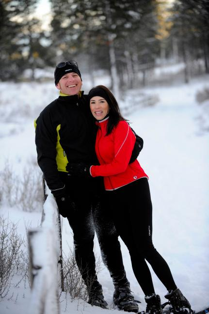 couple snowshoeing at Tartan Druim outside their home for all seasons