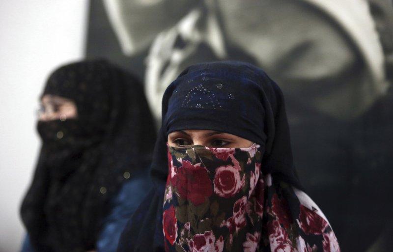 Woman fleeing violence at HAWCA_s facility in Kabul_ _AP Photo_Rahmat Gul_