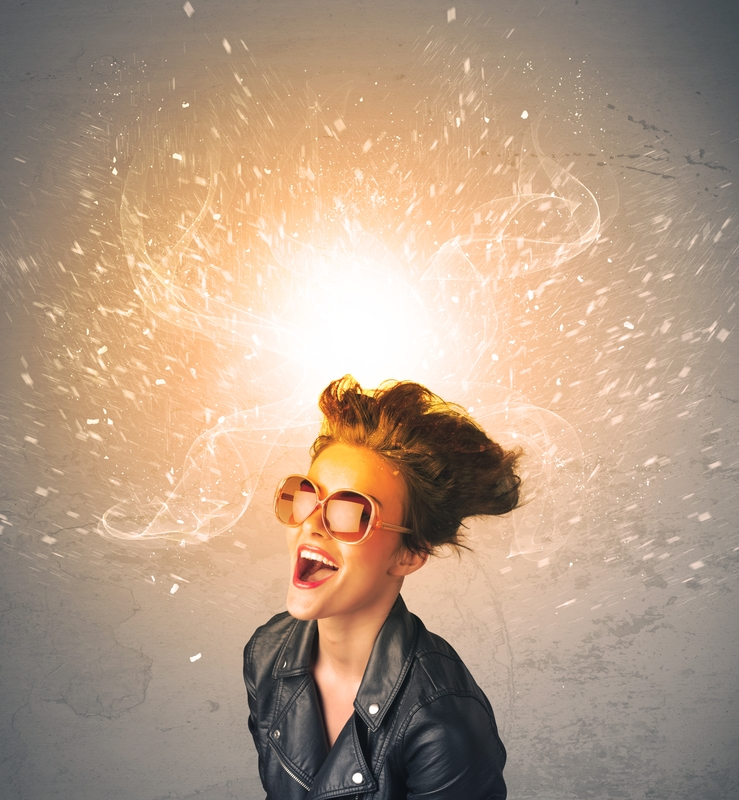 Hip woman with sunglasses and sparks above her head