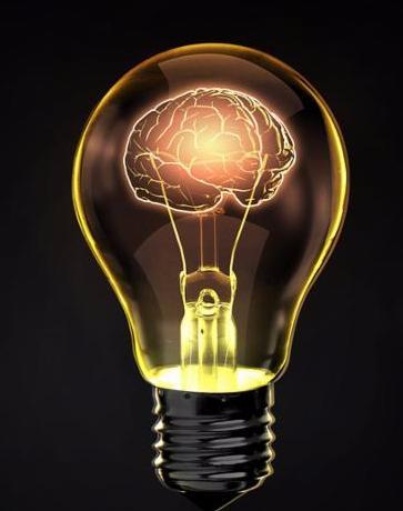 Light bulb with human brain inside on dark background