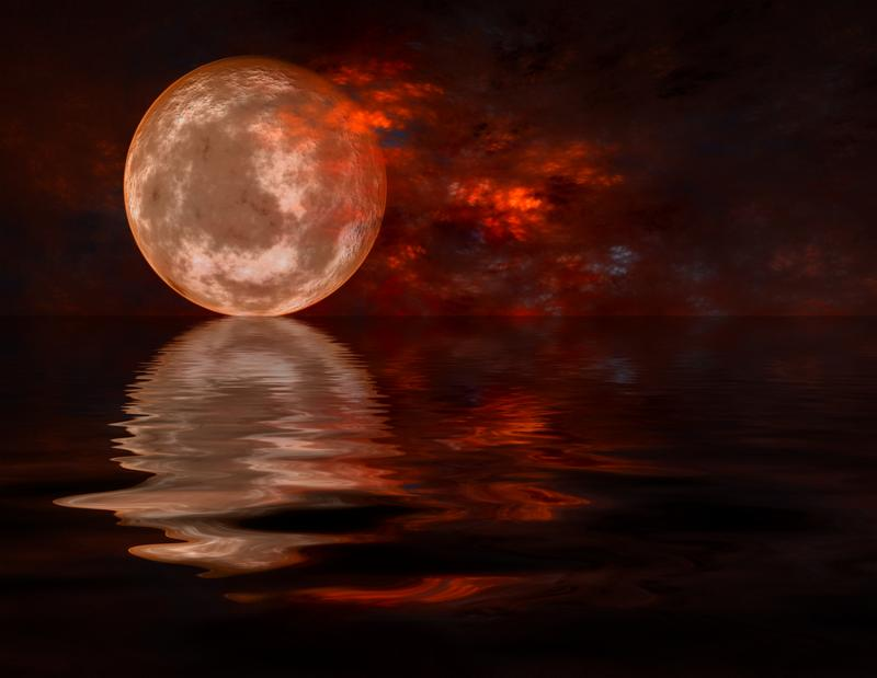 A Detailed Full Moon Rising From Water