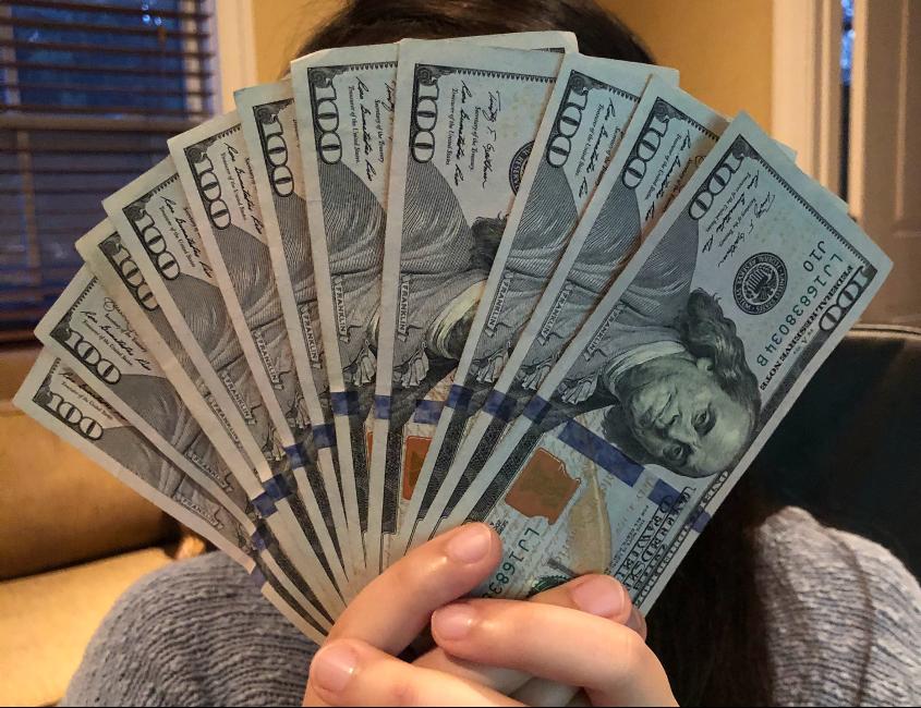 Money Hiding Face Crop.png