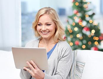 Woman Smiling With Tablet