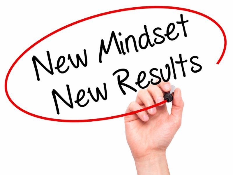 Man Hand writing New Mindset New Results with black marker on visual screen. Isolated on white. Business technology internet concept. Stock Photo