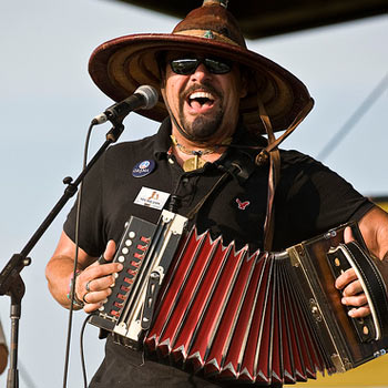 Terrance Simien holding an accordion.